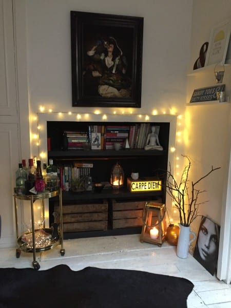 dining room cupboard with fairy lights and drinks trolley