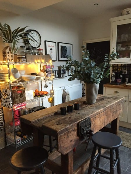 kitchen table with metal storage and fairy lights