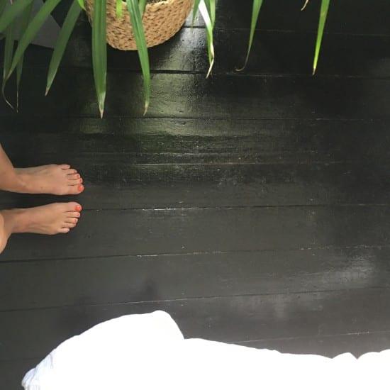 Stained bedroom floor, feet