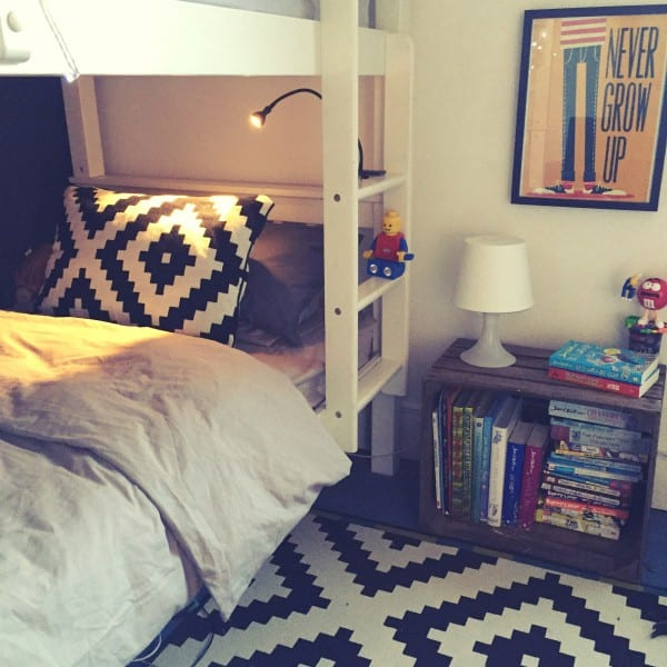 kids whute bunk beds, geometric black and white furnishings, fairy lights