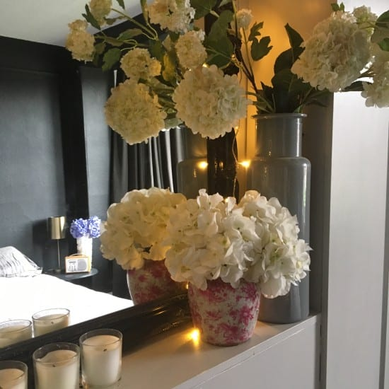 bedroom styling, bedroom, faux flowers, faux hydrangeas, styling, mirror