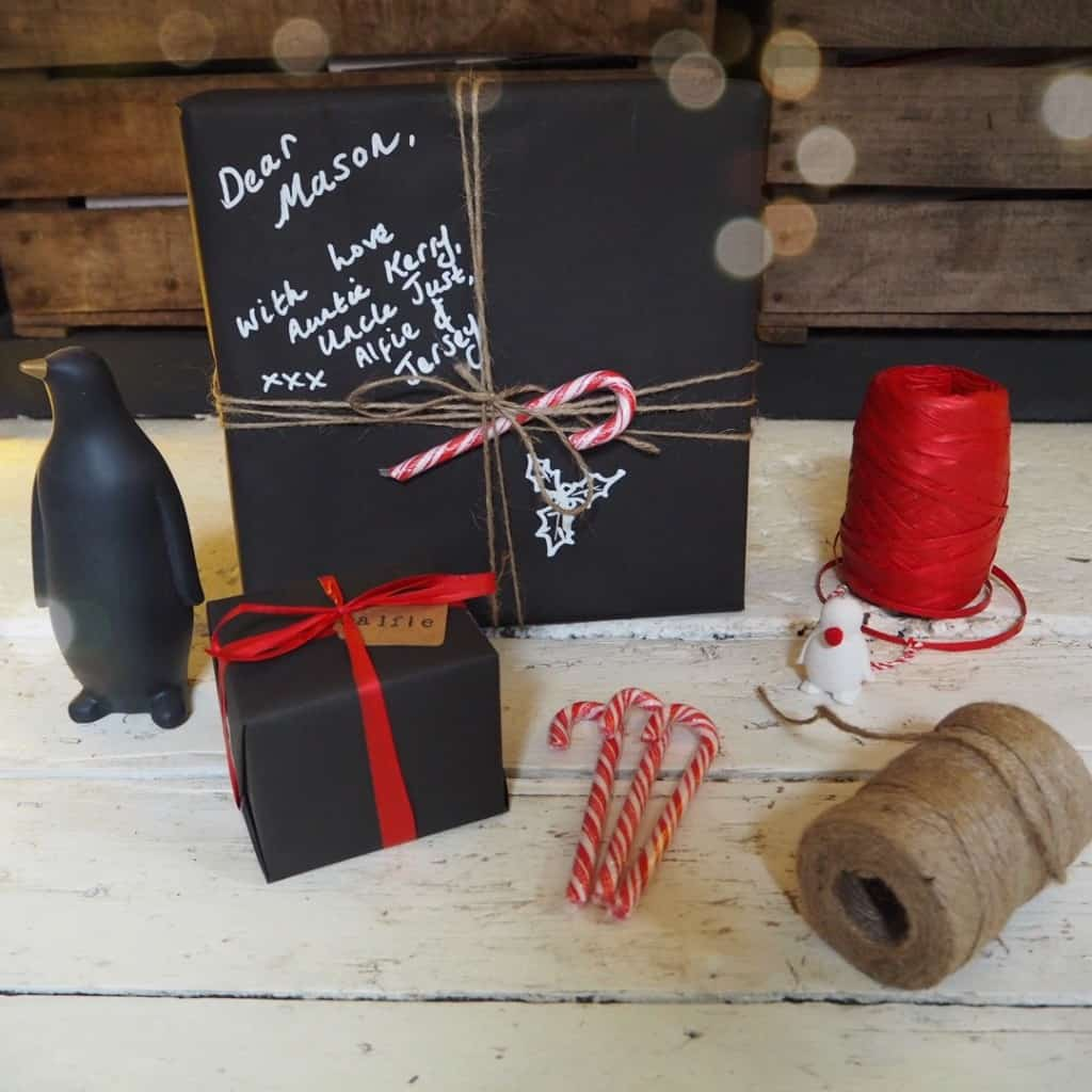 Stylish Christmas gift wrapping ideas, chalkboard paper, red ribbon
