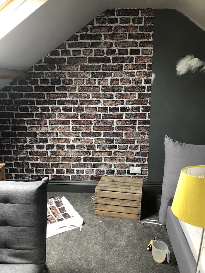 An exposed brick feature wall with rebel murals