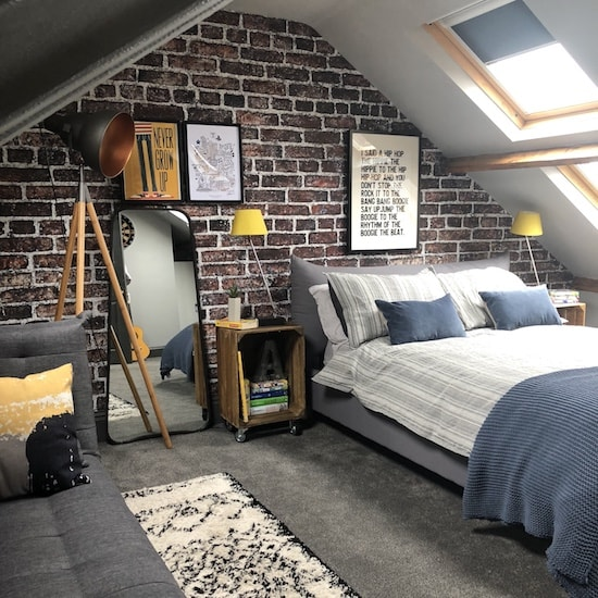 An exposed brick feature wall mural with Rebel walls.