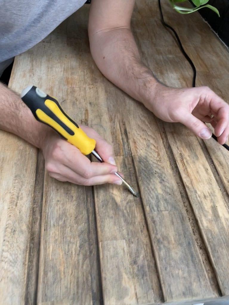 Using a screwdriver to revoke black areas
